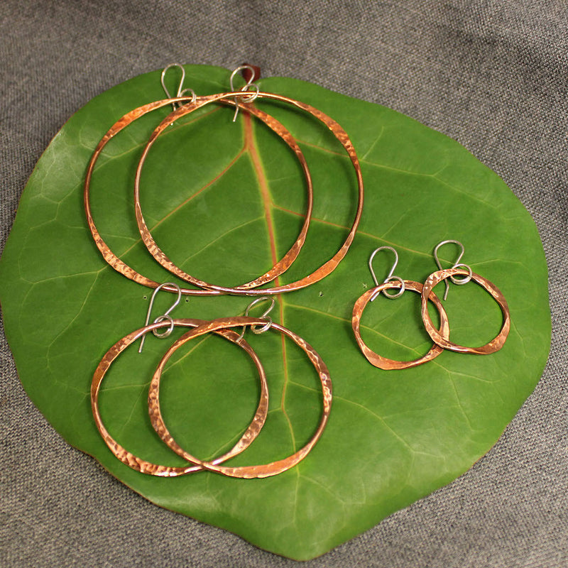 Small, medium and large handcrafted artisan copper hoop earrings.