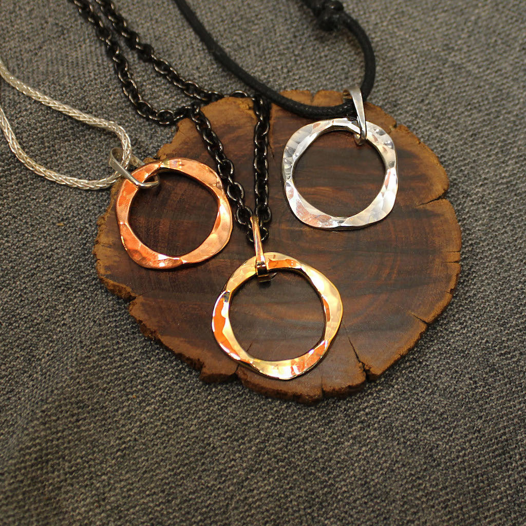 Handcrafted artisan pendants with circular design available in copper, sterling silver and 14k gold.