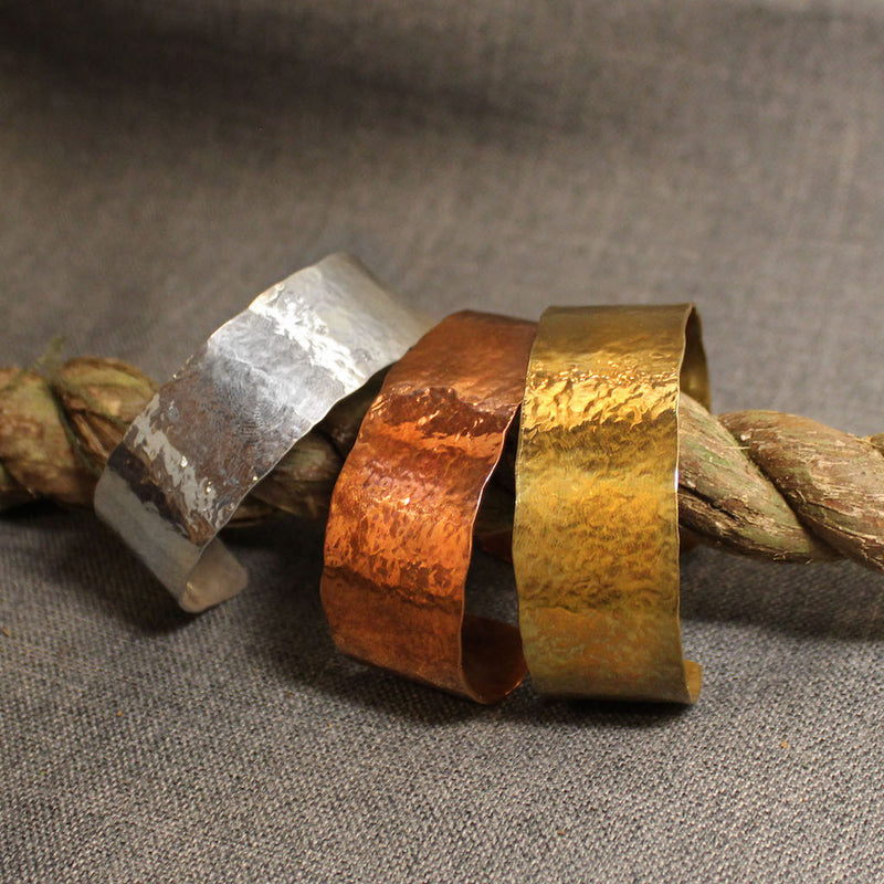 Hammered wide cuff bracelets available in copper, sterling silver and 14k gold.