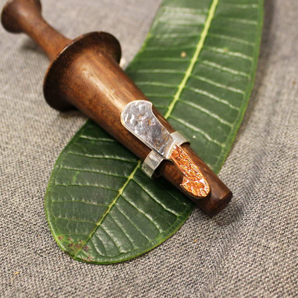 Sterling silver hammered and hand carved machete ring.