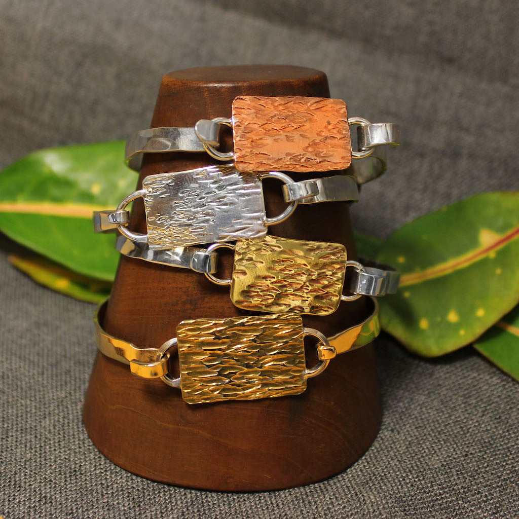 Copper, sterling silver and 14k gold 5mm latching bracelet with hammered rectangular plate in center.