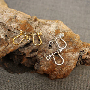 Sterling silver and 14k gold Sailor's Shackle earrings.