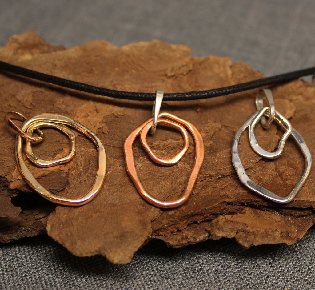 Copper, sterling silver and 14k gold shard shaped pendants.