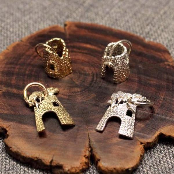 Handcrafted artisanal 3D and flat sugar mill charms.
