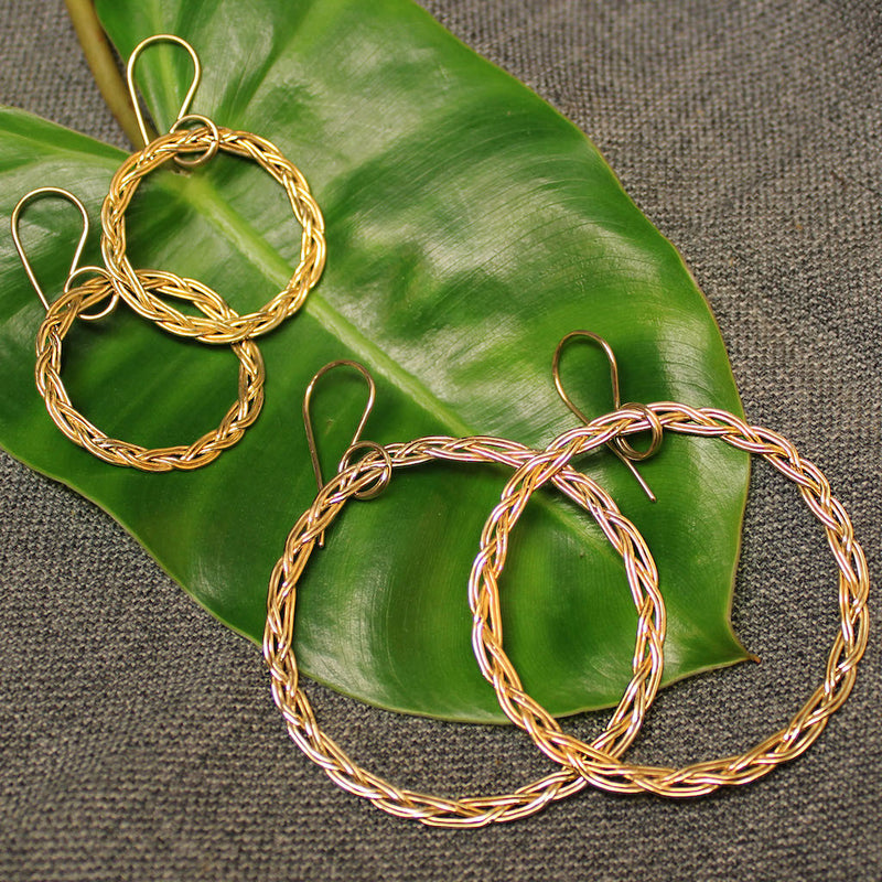 Small and large 14k gold hoop earrings with rope design.
