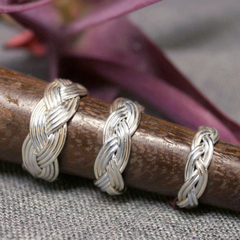Small, medium and large sterling silver rings with Turkshead knot rope design.
