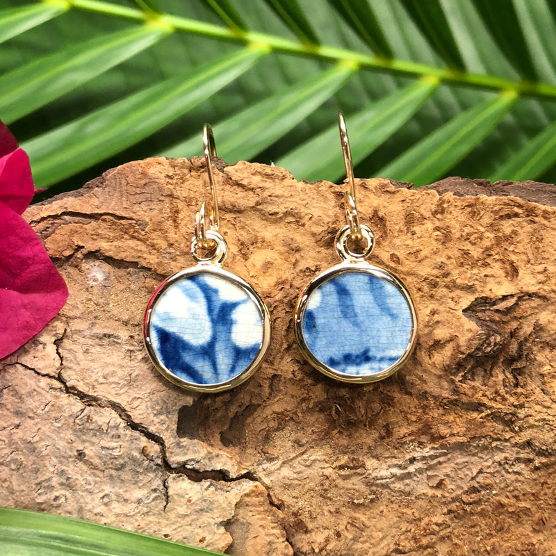 Round 14k gold earrings with blue and white Chaney inlay.