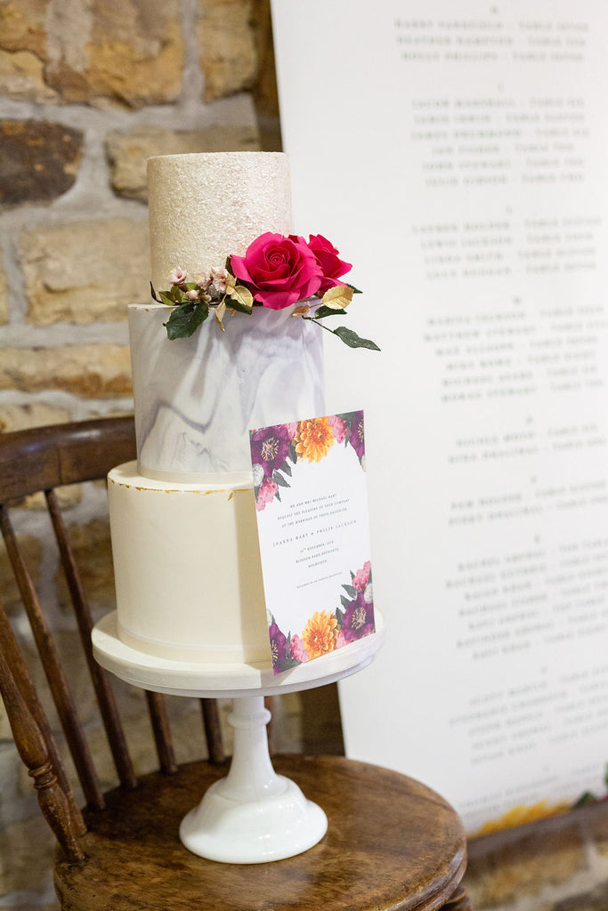 faux flowers afloral boho blossom barn wedding cake