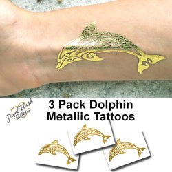 Gold dolphin tattoo | Jewel Flash Tattoos photo