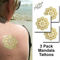 Metallic Gold Mandala tattoo on the back | Photo by Jewel Flash Tattoos