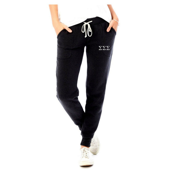 Tri Sigma jogger sweatpants with Greek Letters in black, warm fleece, slim fit. #TriSigma clothing you will love to wear! Shop #SigmaSigmaSigma Clothing Collection for other coordinating items available only at M&D Sorority Gifts! #SSS