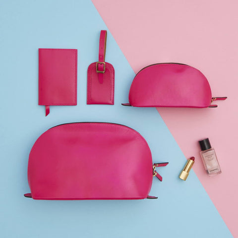 Bright pink ladies leather travel set makeup bag and more