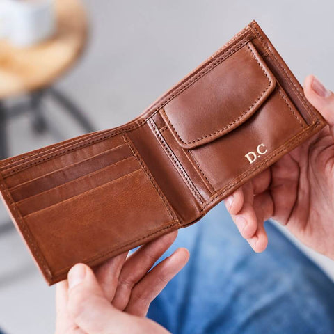 Tan leather wallet with coin section open