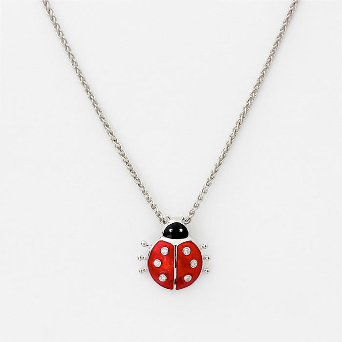 ladybird pendant with red enamel and stones with silver necklace