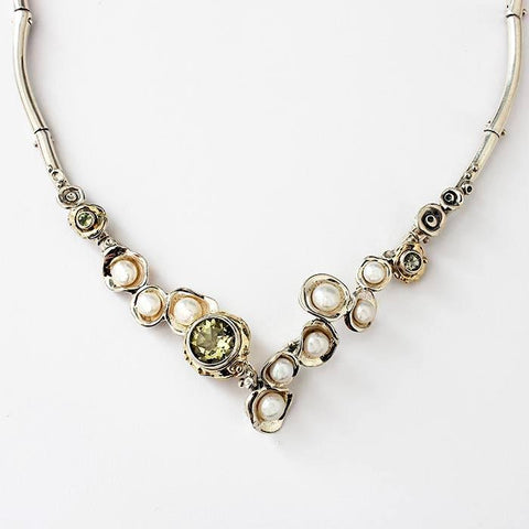 a peridot and pearl collar necklace in sterling silver with an abstract setting