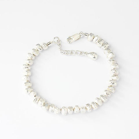 a sterling silver nugget pebble design solid link bracelet with extendable extra links