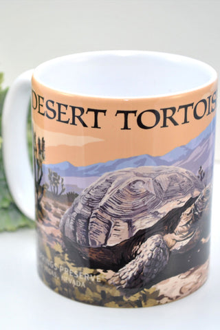 "Mug with desert tortoise illustration, saying ""Desert Tortoise Habitat"" around the rim."