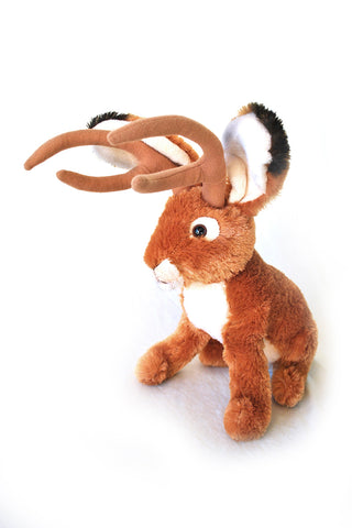 Brown and white jackalope plush with antlers
