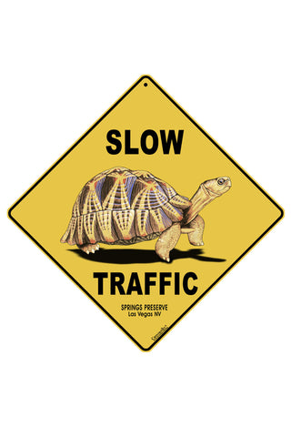 "Yellow sign with ""slow traffic"" text and tortoise illustration"