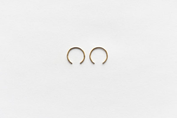 Minimalist earrings in 14K Gold Filled and Sterling Silver made in New York by 8.6.4. Design at Port of Raleigh
