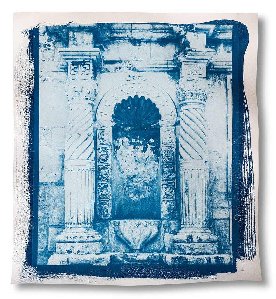unique, one-of-a-kind, handmade cyanotype print of an architectural detail photograph of two carved stone pillars and a niche on the front of the Alamo.