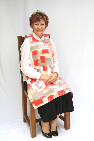 Protect Clothing from spills with Utensils design Dining Drapron®, Specially designed for people with dementia. Lively red and beige pattern that looks equally good on men or women. So much more dignified and attractive than an adult bib
