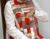 Showing pocket on red baking utensils patter dining drApron®. Protects clothing from spills and is much more dignified and attractive than an adult bib.