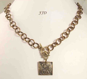 Bronze and Antiqued Brass Initial Necklace