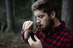 millennial smoking from a pipe bought from up-n-smokes online smoke shop