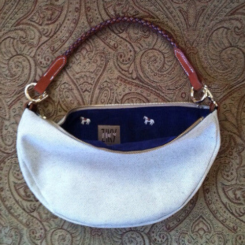 Purse with horse brow band handle