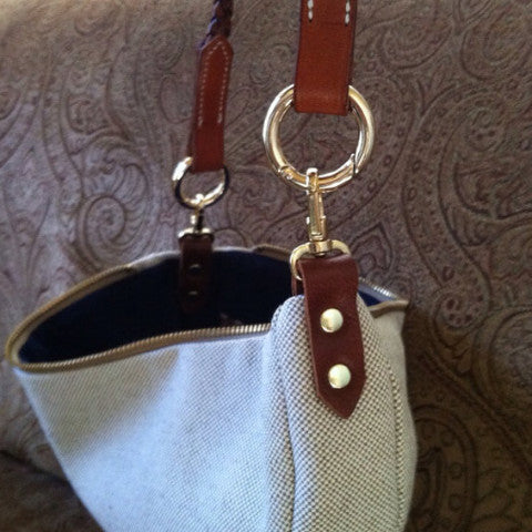 Clutch with horse brow band handle