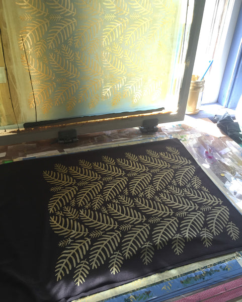 printmaking process, silkscreen table, hand-printed scarf with tropical leaves pattern, handmade in Maine by Morris and Essex