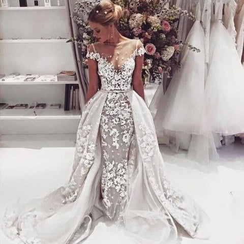products/Unique_Design_Cap_Sleeves_Lace_Illusion_Popular_Wedding_Dresses_Princess_Modest_Beach_Romantic_Fall_Ball_Gown.jpg