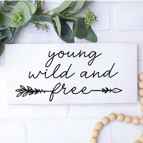 Young Wild and Free Sign