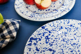 white dinner plates with navy blue splash painted design