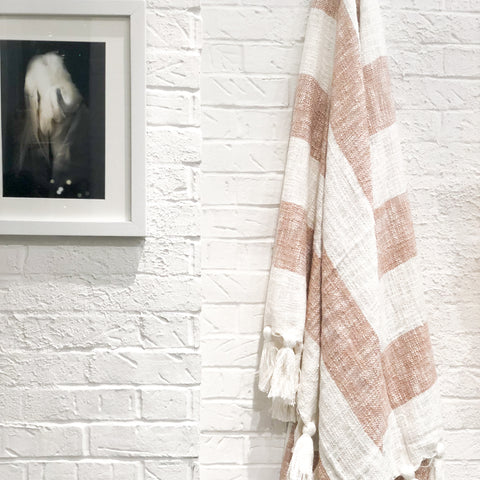 Neutral camel designer throw blanket with tassels