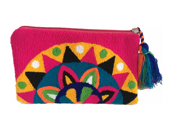 Close up image of Wayuu tapizado small clutch purse with tassel; rectangular shape colored yellow, purple, green, royal blue, teal, magenta