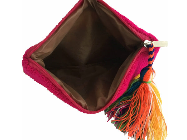 Interior view image of Wayuu tapizado small clutch purse with tassel; rectangular shape colored yellow, purple, green, royal blue, teal, magenta