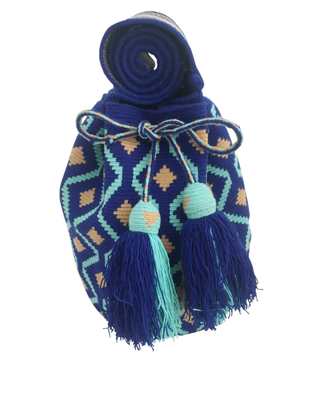 Image of Wayuu mochila purse, drawstring crossbody bag with tassels and cloth strap; royal blue base with light blue and tan design