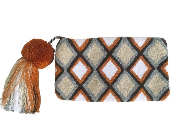 Image of Wayuu small clutch purse with pom pom tassel and zipper; rectangular shaped with tan base color and diamond design with orange, grey and black colors