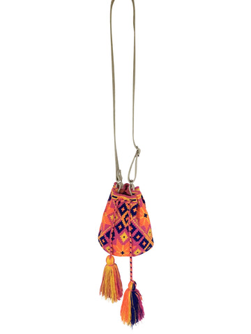 Image of Wayuu mini mochila bucket bag purse with adjustable gray leather strap, drawstring and two tassels; bag is purple base with dark blue, yellow and orange geo design