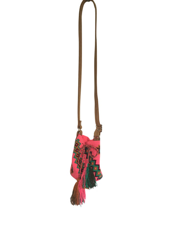 Image of Wayuu mini mochila bucket bag purse with adjustable light brown leather strap, drawstring and two tassels; bag is pink base with teal and brown design