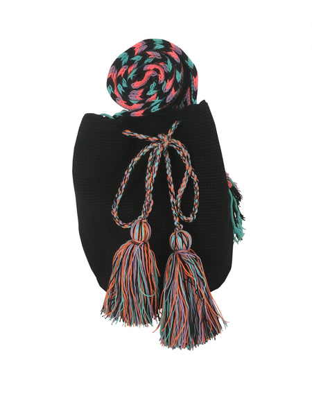 Image of dos hebra Wayuu mochila purse, drawstring crossbody bag with tassels - bag is black with colorful strap and tassels