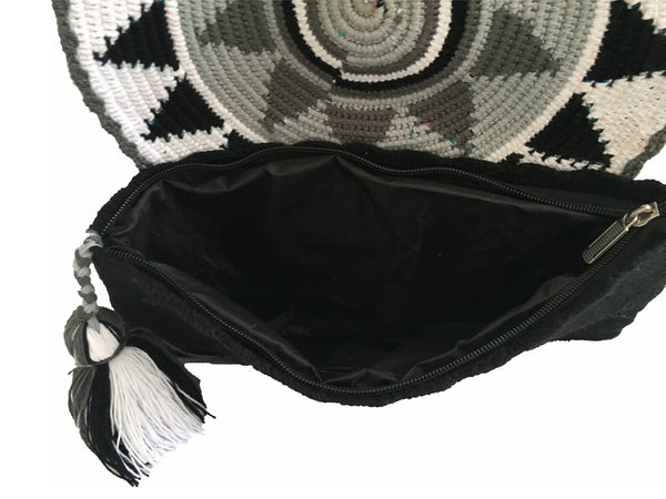 Interior image view of Wayuu small clutch purse with tassel and zipper - envelope style design/black, white and gray colors
