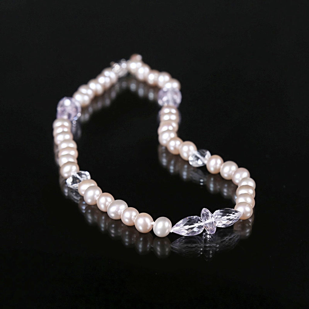 "White Orchid Studios | Made in the USA | Handcrafted couture jewelry inspired by nature. |  A delicate necklace of blush color freshwater pearl, delicate light amethyst, and clear quartz, ending with a silver clasp. 16.5"" $375"