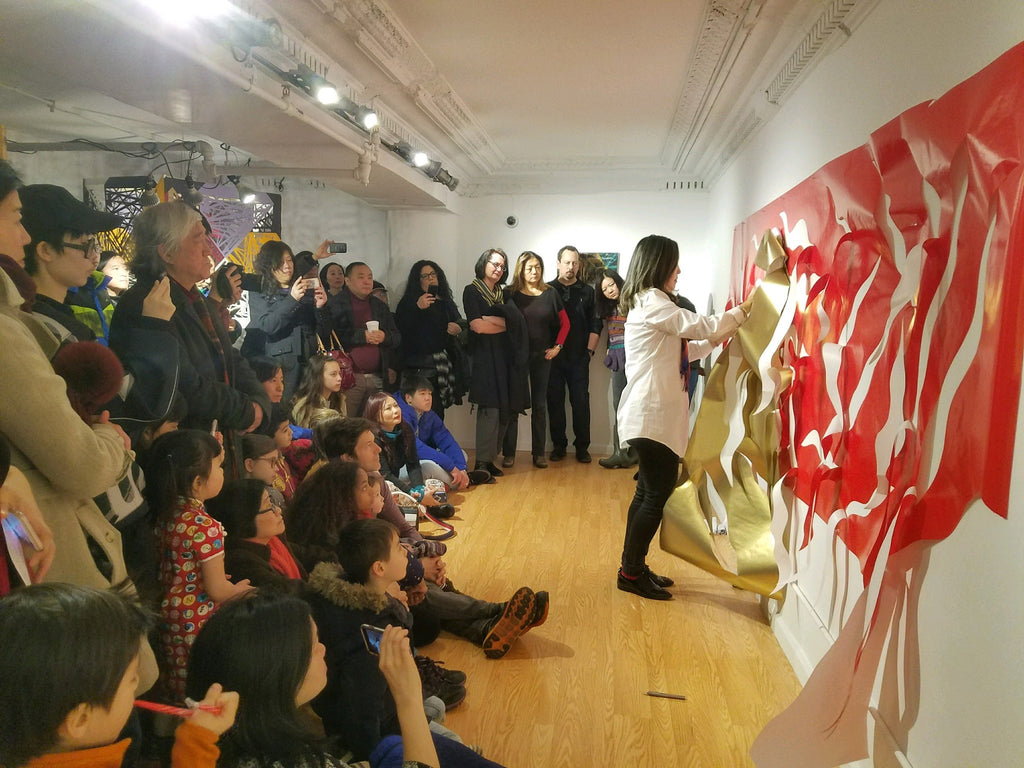 Artist Xin Song during a papercut performance