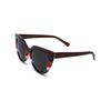 Side view of sunglasses with red multistripe frame solid black lens