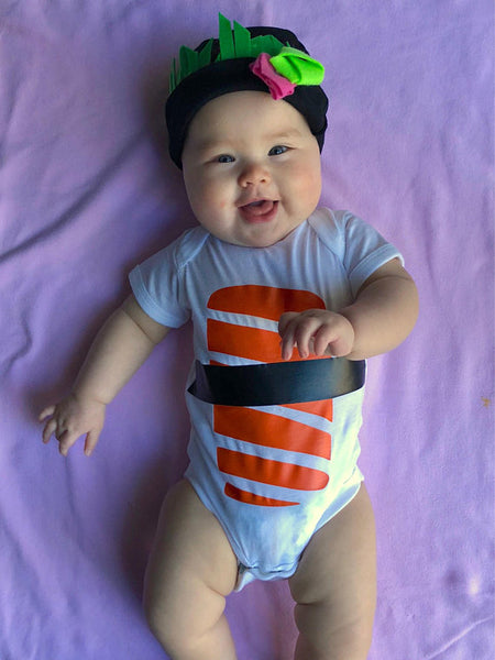 Chubby baby in a sushi onesie and cap