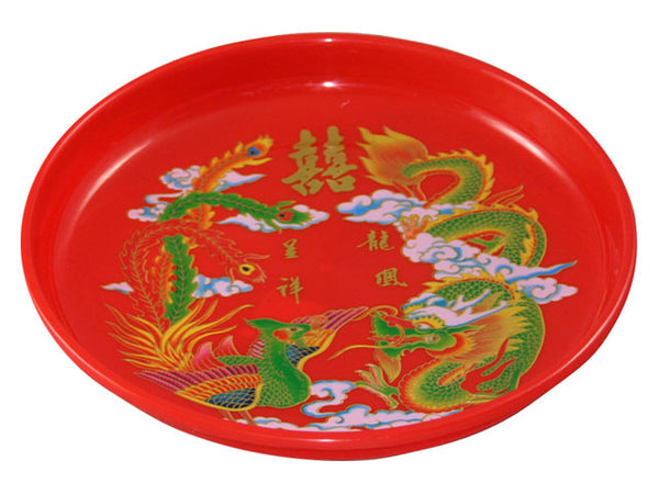 Festive round red tray with brightly colored dragon and phoenix, and gold double happiness character
