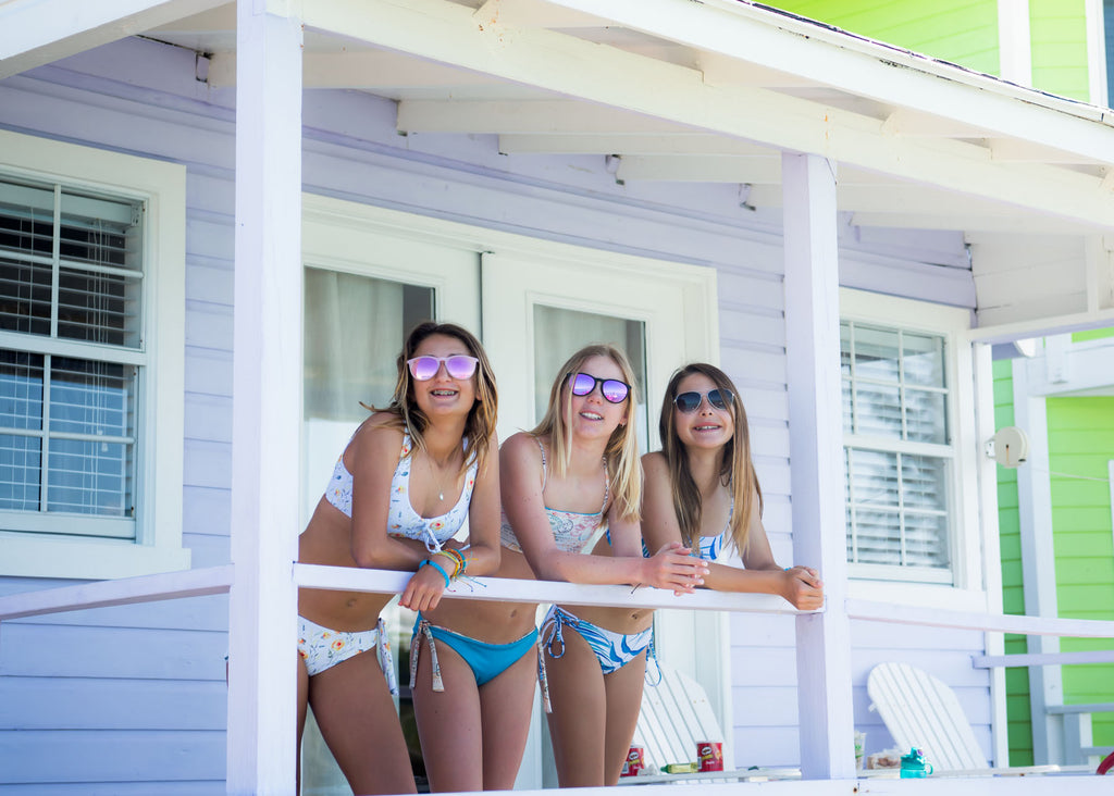 Three Girls standing on the Porch of their vacation Bungalow in Staniel Cay, The Bahamas in their Chance Loves Bikinis